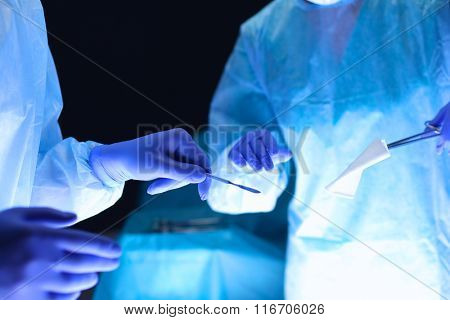 Team surgeon at work in operating room.
