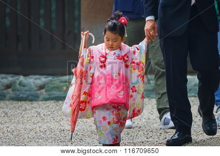 NAGOYA JAPAN - NOVEMBER 18 2015: Parents and Children at Atsuta shrine in a Traditional rite of passage and festival day in held for 3 and 7-year-old girls and 3 and 5-year-old boys