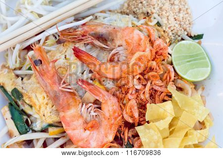 Top View Of Fresh Shrimps Pad Thai, Thai Street Food, Thai Style Noodles. On Paper.