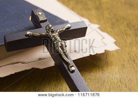 Catholic Cross With A Crucifix On Manuscripts