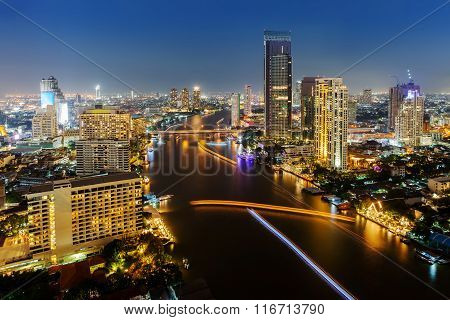 Skycrapper View Of Bangkok City With Rive At Night Time.