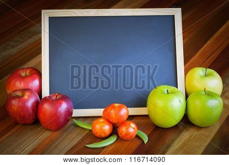 Apples, Tomatoes, Sunflower And Blackboard Composition