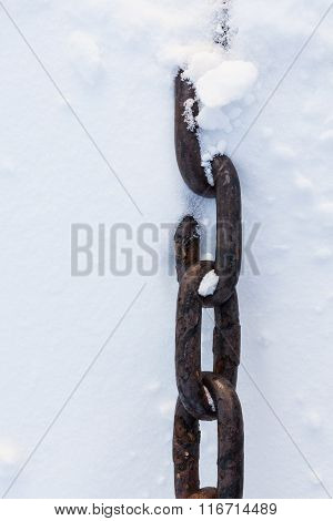 Strong chain in snow close-up