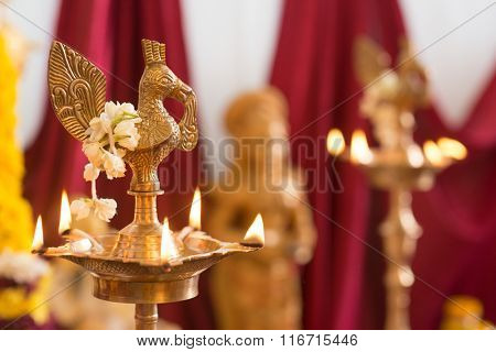 Metal diya. Traditional Indian Hindus religious ceremony. Focus on the oil lamp. India special rituals events.