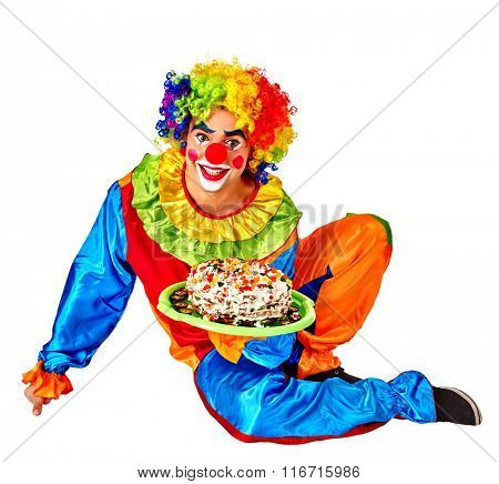 Happy male birthday clown holding cake.  Chidhood concept. Isolated.