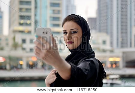 Young beautiful Emirati arab woman taking selfie
