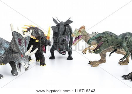 Tyrannosaurus And Stegosaurus And Styracosaurus And Allosaurus And Triceratops Toys On A White Backg