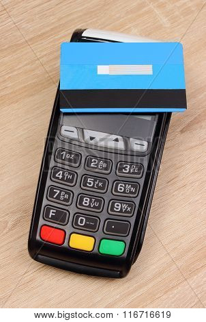 Payment Terminal With Contactless Credit Card On Desk, Finance Concept