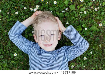 Kid At The Grass