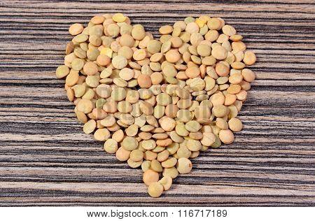 Heart Of Green Lentil On Wooden Background