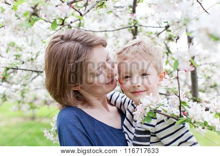 Mother And Son At Spring