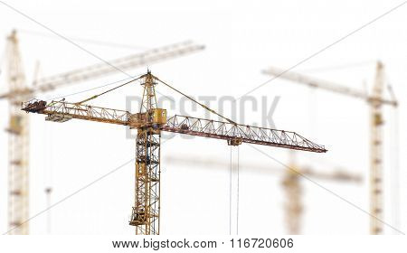 yellow hoisting cranes isolate on white background
