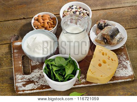 Foods Highest In Calcium On A Wooden Board.
