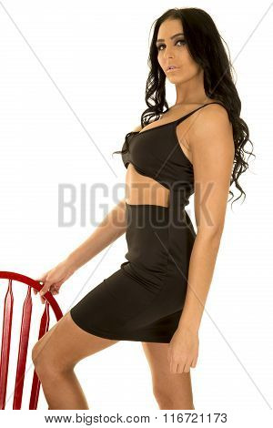 Woman In Black Top Hand On Red Chair Standing