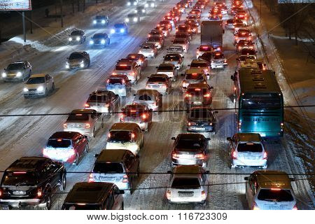 NOVOSIBIRSK, RUSSIA - JANUARY 21, 2015: Car traffic in the city center in a winter evening. The city reached the milestone of 1 million inhabitants in 70 years, and is one of the first in the world
