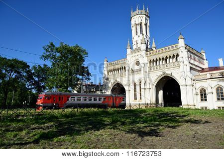 ST. PETERSBURG, RUSSIA - JUNE 7, 2015: Commuter train departs from the train station Novy Peterhof. The station was built in 1854-1857 by design of N Benois