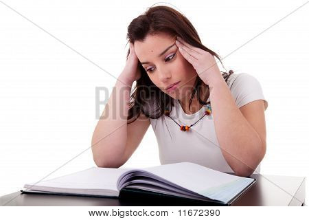 Woman Studying With Headache On White Background. Studio Shot