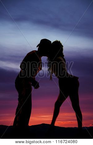 Silhouette Of Woman In Short Skirt Kiss Cowboy