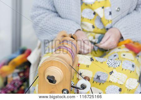 Woman Handspinning Wool