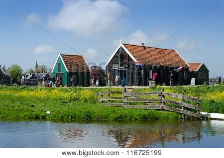 Zaanse Schans, Netherlands - May 5, 2015: Tourists Visit Rural Houses In Zaanse Schans