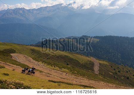 Horseback riding in the Caucasian mountains