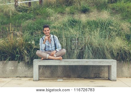 Young Handsome Mansitting On A Concrete Bench