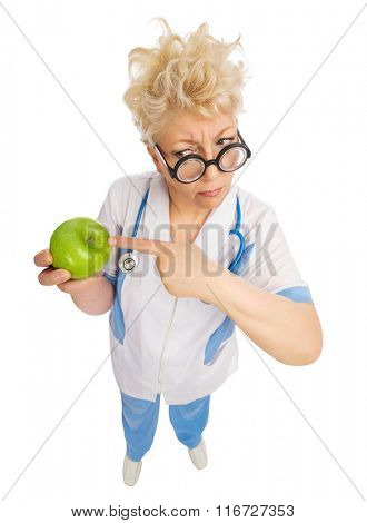 Funny mature doctor with apple isolated