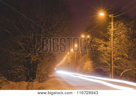 Front Lights Of Car On Snowy Road By Winter Night