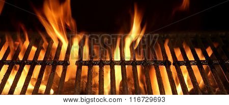 Empty And Clean Hot Flaming Charcoal Barbecue Grill With Bright Flame Isolated On Black Background. Party Picnic Braai Cookout Concept