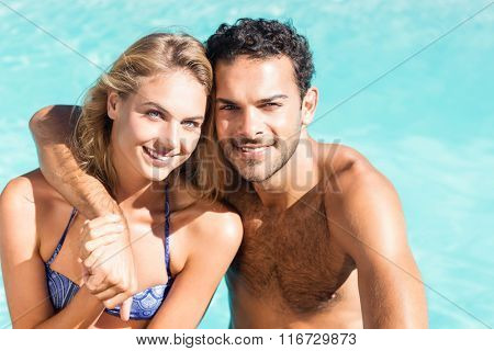 Cute couple hugging by the pool