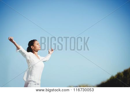Calm brunette doing yoga in a sunny day