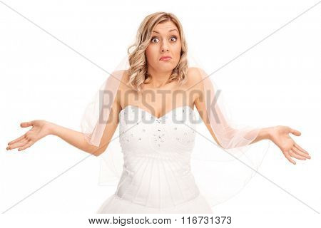 Studio shot of a confused young bride gesturing with her hand isolated on white background