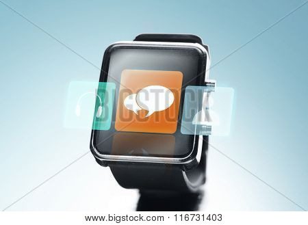 close up of black smart watch with messenger icon