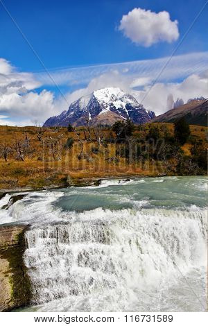 South of Chile. Scenic powerful and high-water waterfall