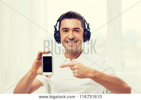 happy man with smartphone and headphones