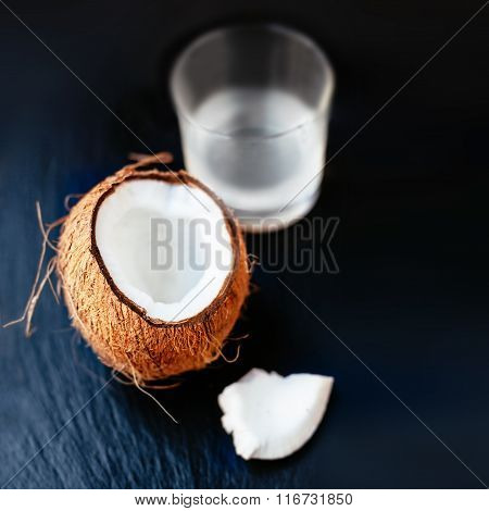 Coconuts With Milk. Coconut With Coconut Milk In A Glass On Dark Background