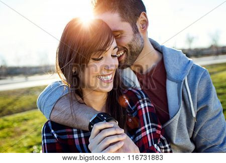 Happy Young Couple Having Fun In A Park.