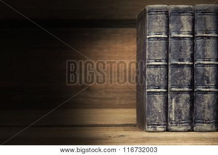 Three Old Shabby Books With Black Leather Cover Horizontal Background