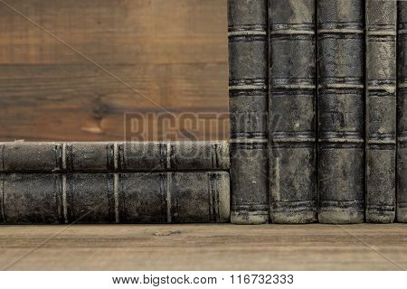 Six Old Shabby Books With Black Leather Cover Horizontal Background