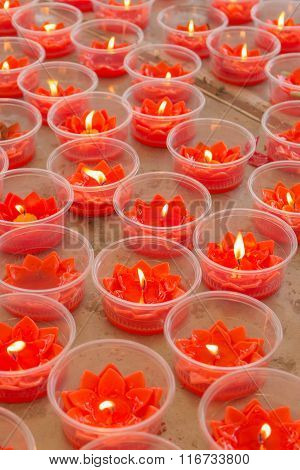 Burning Red Flower Candle At Chinese Shrine For Making Merit In Chinese New Year Festival. Pray For