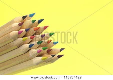 Large Group Of Colored Pencil Isolated On Yellow Background