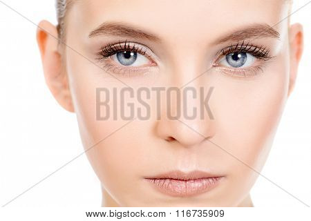 Close-up portrait of a beautiful young woman with natural make-up. Spa girl. Skincare, healthcare. Studio shot. Isolated over white.