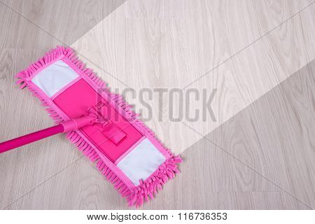 Before And After Cleaning Concept - Pink Mop On Wooden Floor