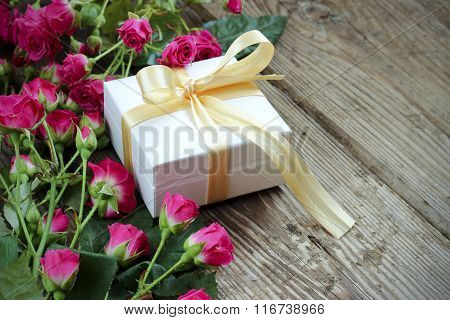 Pink Roses And Gift Box Over Wooden Table, Holiday Background