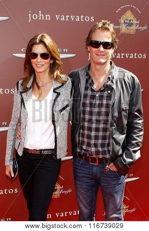 WEST HOLLYWOOD, CALIFORNIA - March 11, 2012. Cindy Crawford and Rande Gerber at the John Varvatos 9th Annual Stuart House Benefit held at the John Varvatos Boutique, Los Angeles.