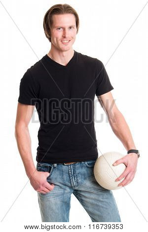 Man in jeans and black tee shirt with volleyball. Studio shot over white.