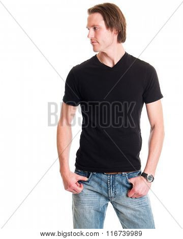 Man in jeans and black tee shirt. Studio shot over white.