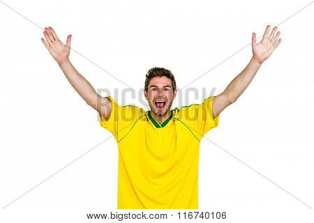 Portrait of handsome man with arms raised on white screen