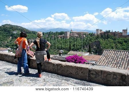 Tourists looking at the Palace of Alhambra, Granada.