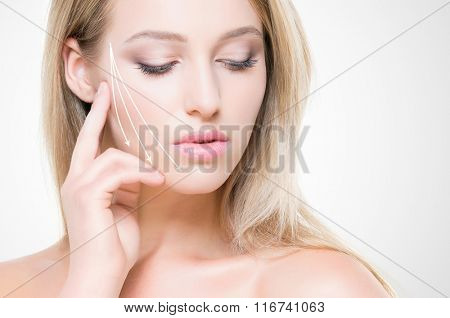 Portrait of beautiful, young woman with pure and smooth skin. Face lifting concept.